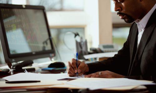 thoughtful-man-analyzing-documents-500x300